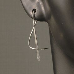 I want!  Sterling Silver Earrings - A Wisp of Silver - Artisan Hammered  Minimalist Unique MetalRocks Design - A Little Twisted. $24.95, via Etsy.