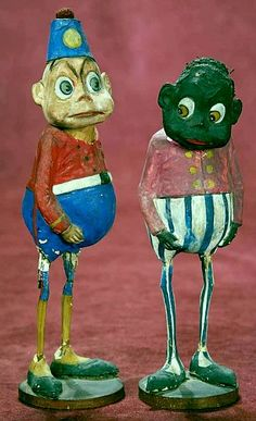 Two German Paper Mache Brownies as Candy Containers. Circa 1895.