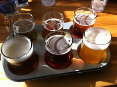 Flight of craft beers served in a muffin tin. Great party idea.