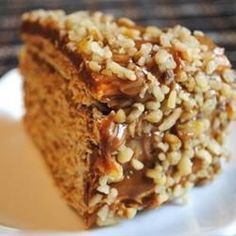 """Called """"Cake of Leaves"""" or """"Thousand Layers Cake"""", this special occasion dessert has 10 thin layers sprinkled with brandy, chopped walnuts, and dulce de leche caramel."""