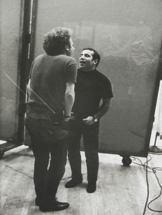 Simon & Garfunkel, singing in the studio