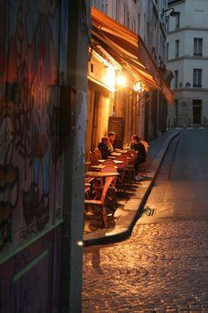 Late night on rue Mouffetard, Paris. Scene of Van Gogh 'Starry Night'