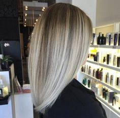 Straight platinum blonde balayage by Capelli