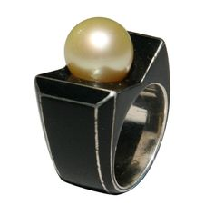 Boivin Art Deco Ring  France,1930's  An Art Deco ring by Rene Boivin in sterling silver, black enamel and a round cultured pearl measuring approximately 10.9 mm. Unsigned . Accompanied by document from Francoise Cailles, Boivin authority, authenticating the ring.