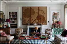 Carolina Irving's Paris apartment ~ mixing ikat, bold stripes, floral motifs and paisleys.