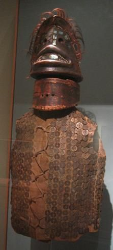 Native american (Sitka Alaska) Tlingit leather war dress plated with Chinese coins. The Tlingit received Chinese coins in trade from Boston sea merchants in exchange for sea otter pelts. Chinese coins were used as currency during the Qing dynasty. Most were minted in the Shunzhi (1644–62), Kangxi (1662–1723), and Yongzheng (1723–36) eras, as identified by their reign marks.