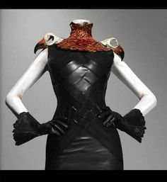 Part of Alexander McQueen's Savage Beauty collection, this piece with bird skulls as accents on the shoulders. Very #Goth-cool