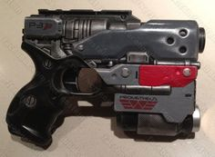"My homage to the film ""Prometheus"". Blaster pistol with Alien Weyland Yutani (or probably just Weyland) twist. Base gun a Nerf Element. My most anticipated movie of 2012!"