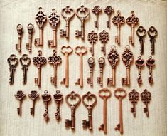 Keys to the Kingdom - Skeleton Keys - 36 x Vintage Keys Antique Copper Skeleton Key Old KEys Skeleton Keys Set. $16.00, via Etsy.
