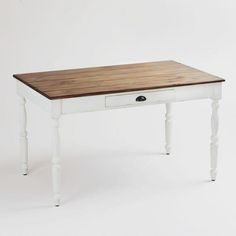 Desk Idea instead of making one out of the dining table. One of my favorite discoveries at WorldMarket.com: White Camille Dining Table