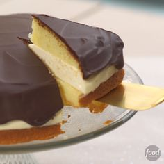 Recipe of the Day: Boston Cream Pie Cheesecake You've got a holiday party coming up and can't decide: Should you bake a cake? What about a cheesecake? We've all been there. But you'll never have to choose again. Combine two beloved desserts into one delicious mashup and forget all future dessert dilemmas.