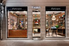 diptyque ville rose perfume retail shop design, black pole perfume shop display shelf, perfume display stand, perfume metal and wood till counter