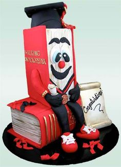 """""""Top of the Class"""" Walking Encyclopedia Cake by Susan Carberry - Give that graduate a cake the he or she deserves! Susan Carberry's """"Top of the Class"""" Walking Encyclopedia Cake shows the pride and fun of watching someone reach a goal in life."""