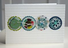 four fun circles, each with its own stuff on top form a band across this card...