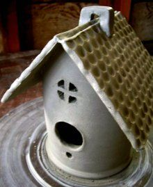 The base of this bird house is thrown, then trimmed and other parts added.