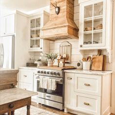 If you are inspired by french country kitchens and modern farmhouse kitchens you have come to the right place. This kitchen is dreamy with the shiplap walls and reclaimed wood. I adore the white kitchen cabinets and vintage home decor. Kitchen Cabinet Design, Dream Kitchen, Kitchen Remodel, Kitchen Decor, New Kitchen, Home Kitchens, Rustic Kitchen, Kitchen Design, French Country Kitchens