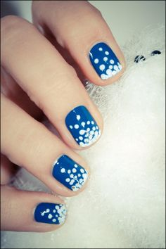 Blue polish with white polka dot snow flakes and a bit of silver sparkle at the tips