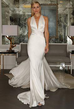 A sleek, sexy halter #weddingdress | @romonakeveza | Brides.com
