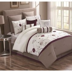 Fall in love with the Lourdes 10-piece embroidered Comforter Set. It will add harmony to your home with its soothing Ivory, Taupe, and Plum. The comforter features a classy floral design and is soft to the touch because it's made of 100-percent polyester.
