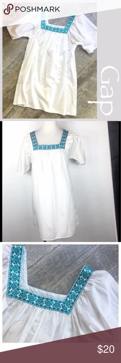 """Gap Caftan style Top. Gap Embroderied Caftan Summer top. Turquoise Embroidered around a square neckline and flown sleeves. Size small. Preowned. Cotton, Measurements  Bust 18"""" Length 31"""" from shoulder. Bundle in my closet and save. Fascia per Ann suggested user and top-rated seller. No trades. GAP Tops Blouses"""