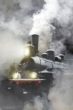 this is one of my fav photos with the train stream and mist all around--I can imagine being right there.