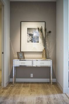 how-to-decorate-the-end-of-a-hallway-that-is-long-or-narrow-with-an-accent-table-decor-and-artwork-via-kcs-estates