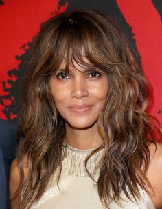 The cut: Shattered Long Layer Shag With Bangs Celebrity inspiration: Halle Berry What it looks like: This i...