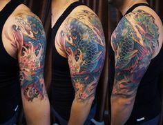 Half sleeve Koi Fish and Lotus tattoo