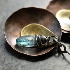 I really wanted to show off the contrast in the metals by using a combo of all 3 in these earrings. I used large copper discs that I hammered
