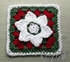 A pretty little flowered granny square, in Holiday colors.