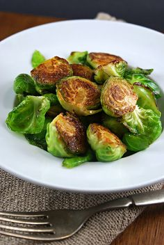 Pan fried brussels sprouts with sriracha, honey + lime