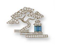 A late art deco diamond and aquamarine brooch, circa 1935