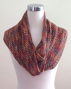 Free Knitting Pattern for Easy One Skein Copilot Cowl - This easy cowl features a mesh lace separated by garter stitch sections. Designed to use one skein of that special fingering weight (4ply) yarn., it can be adjusted in both length and width. Rated very easy by Ravelrers. Designed by Dominique Trad