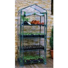 4 Tier Mini Greenhouse by Gardman. $53.39. Small greenhouse with 4 shelves for deck, patio, or balconyIdeal for seed propagation and plant growing and displaySturdy shelves for pots and seed trays; plastic cover with full length roll up zipperDimensions when built: 62 by 27 by 19 inches (h x l x w); each tier is 12-1/2 inches high