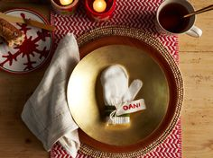 Layer gold and red plates for a more elegant take on rustic. For an adorable touch, use child-sized mittens as placecard holders, just write each guest's name to a label and attach.