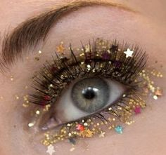What better way to ring in the new year than being smothered in glitter? Check out some of this year's hottest New Year's Eve makeup ideas..