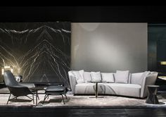 Lounge Seymour seating system and Prince armchair and ottoman, Rodolfo Dordoni Design