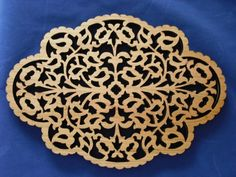 Triangle Custom Creations - Wooden Trivet Intricate Scroll Design Two Sided Cherry and Maple Wood, $28.00  This beautiful trivet can be used to set your warm dishes on to protect your counters and tabletops, or it is delicate enough to use it as a decorative wall hanging. It is made of two woods. Maple on one side, and Cherry on the other. #woodtrivet #lasercut #hotpad #trivet (http://www.trianglecustomcreations.com/wooden-trivet-intricate-scroll-design-two-sided-cherry-and-maple-wood/)