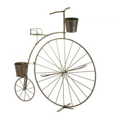 """Adorable Old Fashioned Bicycle Planter. Vintage charm is in bloom! This Adorable Old Fashioned Bicycle Planter looks like a high-wheel bicycle from bygone days, with one large wheel in the front and a smaller wheel in back. Attached are three pails that are ready to hold your blooming plants. This lovely accessory will look great on your patio or in your favorite room.  Item weight: 5.4 lbs. 32"""" x 10"""" x 33"""" high. Iron. Plants not included. The pails measure approximately 5"""" diameter…"""