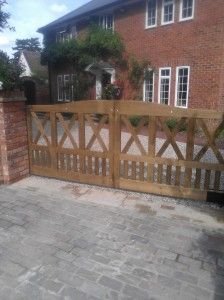 Bespoke design wooden driveway gates crafted from pressure treated softwood www.crockettsgates.co.uk
