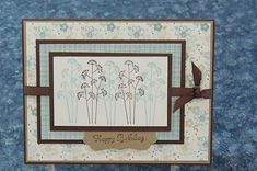 Stampin Up: Pocket Silhouettes. I'd probably use different colours. Like the use of the decorative label punch for sentiment