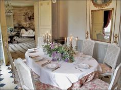 Some day we will have caned dining room chairs.  Love the candelabras!  Elegant dining room  Chateau les Aulnois