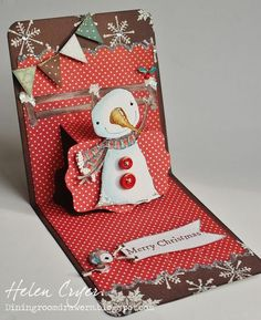 inside view of Christmas card by Helen Cryer ... pop-up cwitha snowwomand on a tag ...