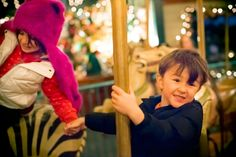 Yesterday was a big family Christmas-type day. We picked out our tree, hung  the lights, and visited Santa. Usually we wait in line to see Santa, but on  this day he was taking a break, helping to run the merry-go-round. My