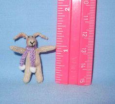 Bunny in a scarf by Jill Rothwell .