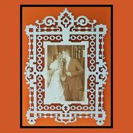 Alice: Engraving photo on frame.
