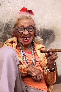 Cuban Lady with cigar by Terry George