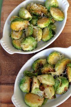 2 lb Brussel Sprouts  4 tbsp olive oil  5 cloves garlic, minced  1 lemon, juiced and zested  3 tbsp gruyere, grated  sea salt  pepper