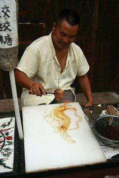 Sugar painting- a traditional Chinese folk art using liquid sugar. Amazing.
