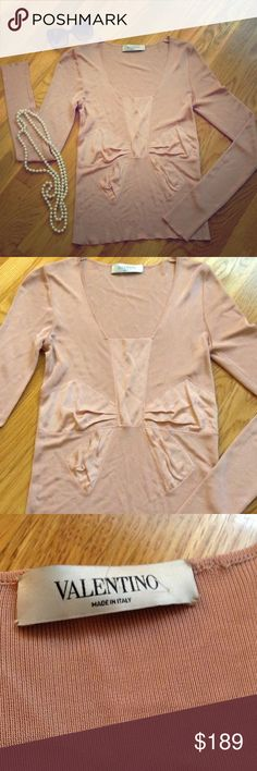 VALENTINO Dusty Pink Bow Shirt Blouse VALENTINO dusty pink bow blouse in size small. Features a scoop neck, long sleeves and a super cute bow embroidered into the front.  Material tag is cut but feels like a slinky, spandex nylon. Bust is 28 inches, sleeves are 25.5 inches and total length is 22 inches. Open to all offers. Retails for $648. Valentino Tops Blouses